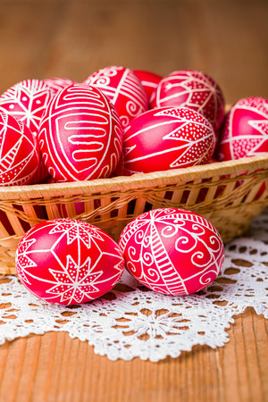 Closeup view of traditional transylvanian hand written Easter eggs in basket