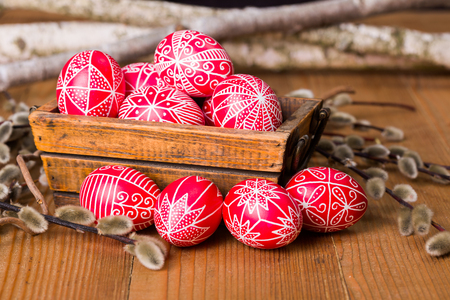 Traditional transylvanian hand written Easter eggs surrounded by willow branches