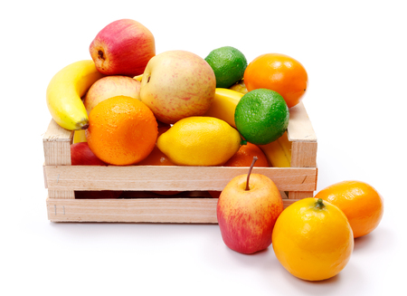 bad banana: Various artificial plastic fruits in wooden crate - concept of bad quality products on the market