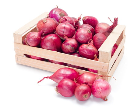 Wooden crate of red onions crop