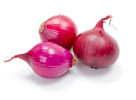 Several ripe red onions on white Reklamní fotografie