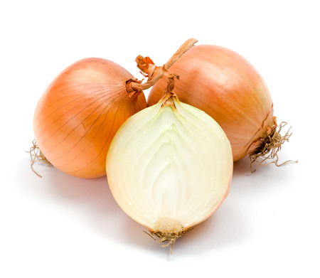 Yellow onions on white background