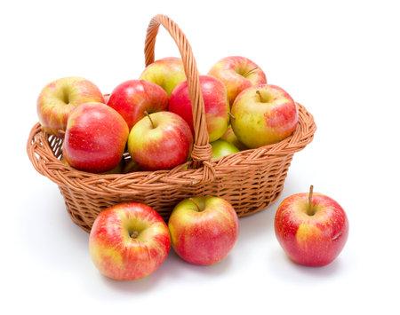 harvest basket: Full basket of fresh ripe red apples crop Stock Photo