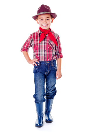 agriculturist: Happy casual agriculturist boy in blue jeans, boots and hat Stock Photo