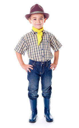 blue jeans kids: Casual little cowboy standing in blue jeans and boots