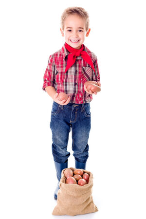 agriculturist: Happy little agriculturist boy showing good potato harvest Stock Photo