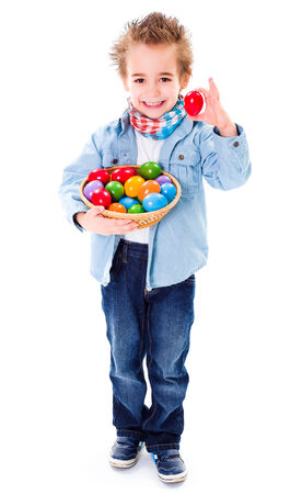 Cute little boy showing an red Easter egg photo