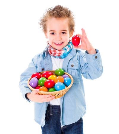 Closeup of cute little boy showing an red Easter egg photo