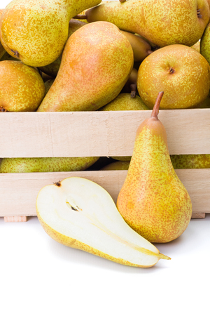 pyrus: Close view of ripe pears in wooden crate. Pyrus communis
