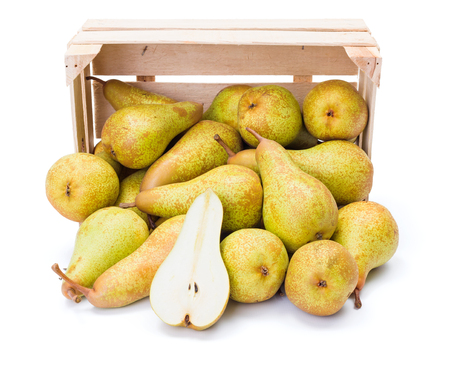 communis: Ripe pears spilled out of the box. Pyrus communis