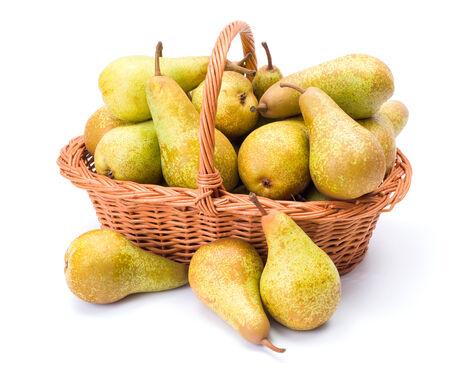 communis: Ripe pears in wicker basket. Pyrus communis