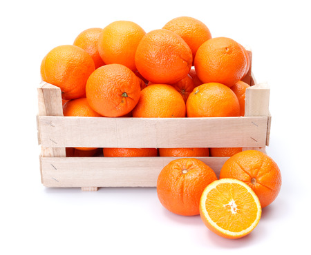 Ripe oranges in wooden box. Citrus sinensis