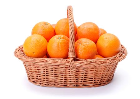 citrus  sinensis: Pipe oranges in wicker basket. Citrus sinensis