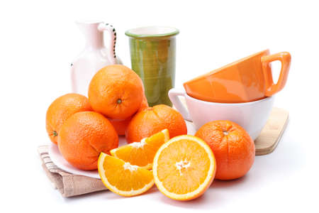 citrus  sinensis: Appetizing ripe oranges on white plate. Citrus sinensis Stock Photo