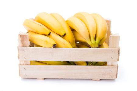 musa: Ripe bananas in wooden box. Musa acuminata