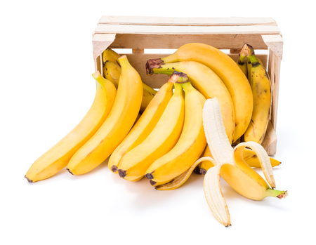 musa: Ripe bananas spilling out of wooden box. Musa acuminata Stock Photo