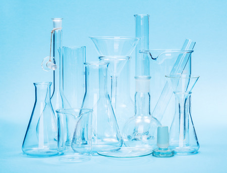 glassware: Various laboratory glassware on blue background