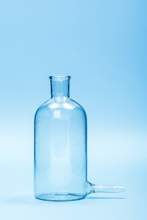 filtering: Chemical laboratory glassware, empty clear filtering bottle