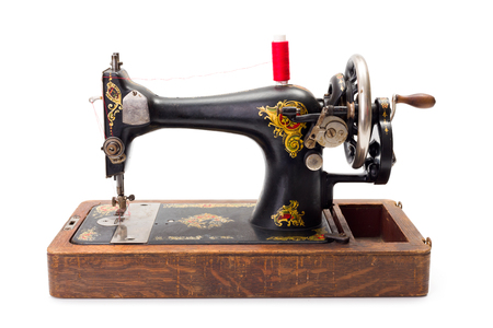 black and white sewing: Old hand driven sewing machine ready for use