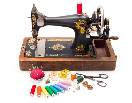 black and white sewing: Old hand driven sewing machine and accessories