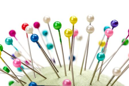 pinhead: Wooden pincushion full with with colorful pins