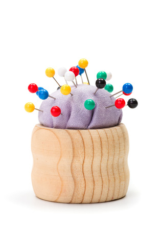 push in pins: Wooden pincushion full with with colorful push pins