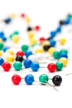 pinhead: Macro of colorful sewing push pins on white