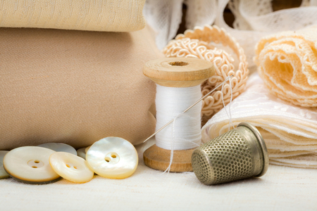 needle laces: Vintage sewing craft items: fabrics, laces, thread, thimble, shell buttons