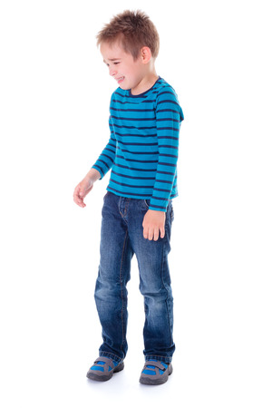 hysterics: Crying little boy standing alone on white