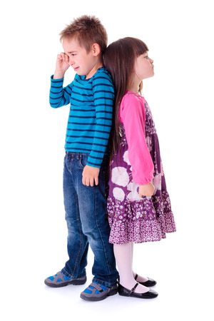 hysterics: Little aggrieved boy crying and standing near angry girlfriend Stock Photo