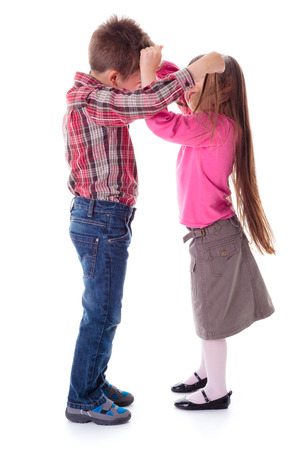 brother sister fight: Fighting children, little boy and girl pulling each other hair Stock Photo