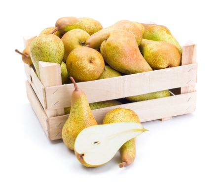 pyrus: Ripe pears in wooden crate. Pyrus communis
