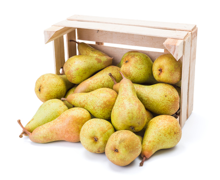 pyrus: Ripe pears spilled out of the box. Pyrus communis