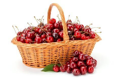 prunus: Sweet cherries (Prunus avium) in wicker basket on white