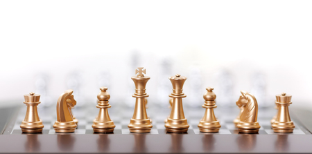 Golden chess pieces in starting position