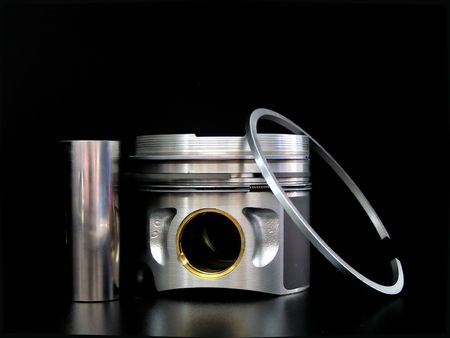 Piston with piston ring isolated on black Stock Photo