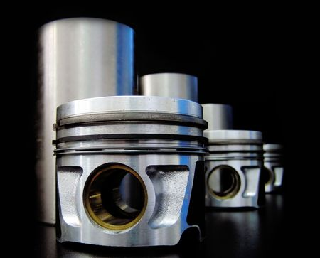 Set of pistons and liners isolated on black Stock Photo