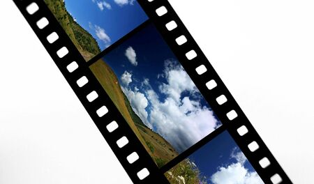 snap: Film strip with landscape snap shots Stock Photo