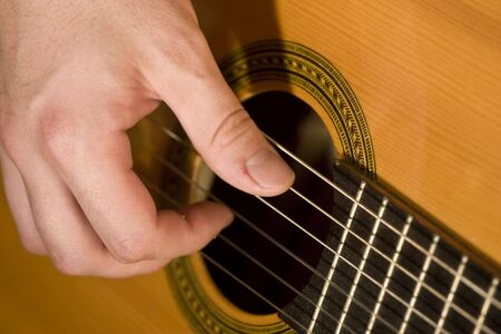 Musician playing classical acoustic guitar Stock Photo