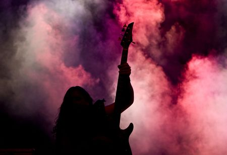 Silhouette of a guitar player live on stage Stock Photo