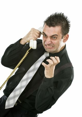angry businessman screaming on the phone  Stock Photo - 7060117