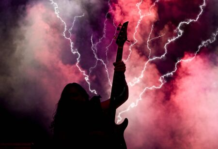Heavy metal musician and lightning photo