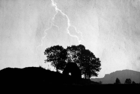 price uncertainty: Lightning over rural house