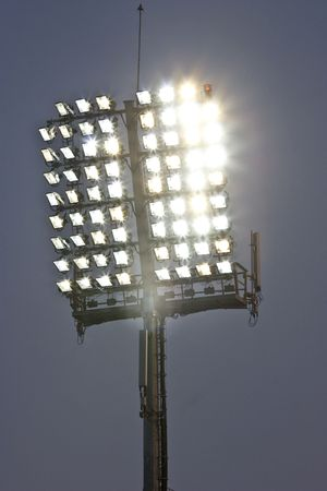 Stadium lights and dark blue sky  photo