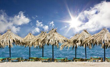 Stock Photo: lounge chairs on beach photo