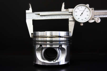 Piston isolated on black Stock Photo - 9007431