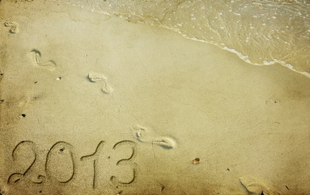 New Year 2013 is coming - numbers written in sand photo