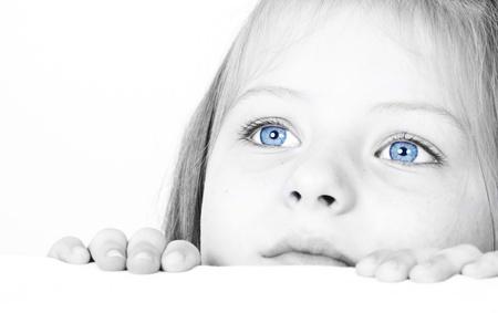 Close up auf einem schönen blauen Augen eines jungen Mädchens Lizenzfreie Bilder