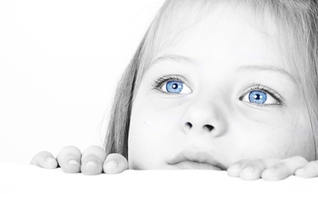 Close up on a beautiful blue eyes of a young girl  Stock Photo