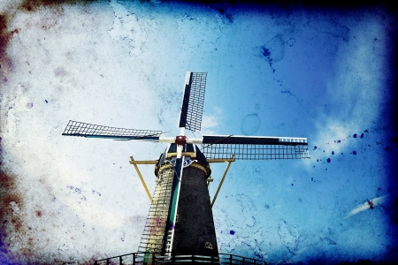 Vintage photo of dutch windmill over blue sky  photo
